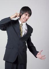 businessman pulling his ear