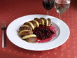 Dish of Italian cuisine - duck with apples and potatoes