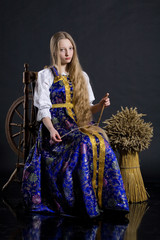Girl And Spinning Wheel
