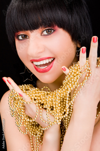 portrait of fashion woman with gold necklace