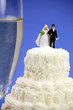 Bride and groom on top of a wedding cake.Marriage concept.