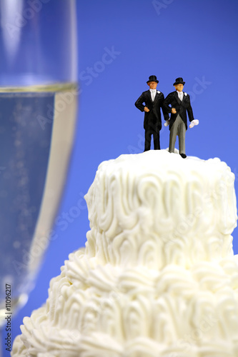 Homosexual couple on a wedding cake. Gay marriage concept.