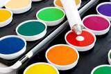 Watercolors with opaque white on black background poster