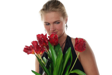 woman with tulips and revolver isolated on white background