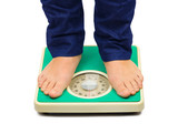 Woman feet and weight scale