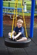 Little Boy on a Playground Tire Swing