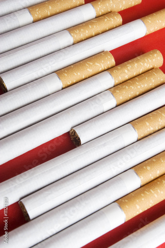 Cigarettes on red background