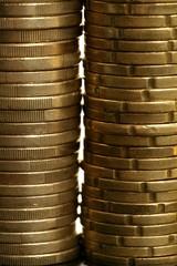 Euro coin columns, golden cash over white background