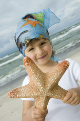 Cute girl holding a starfish