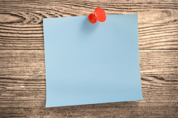 Blue paper note  on wood, clipping path.