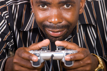 african man play video game