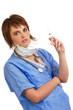 Female nurse holding a filled syringe