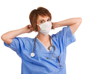 Young adult female nurse prepping for surgery