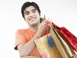 asian male of indian origin with his shopping bags