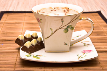 Cup of coffee with chocolate.