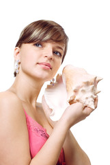 Young woman listening to the seashell
