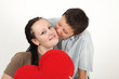Young boy and girl with red heart