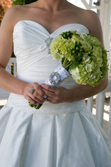 Torso of a bride holding her bouquet