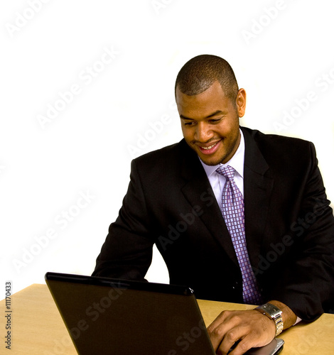 Man Working on Laptop at Desk