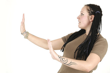 Concentrated woman shows tai chi