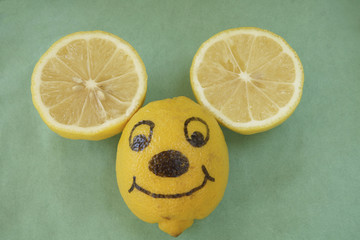 Smiling lemon mouse face.