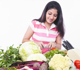 woman cutting some vegetables