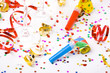 small confetti stars and colorful blowers on white background