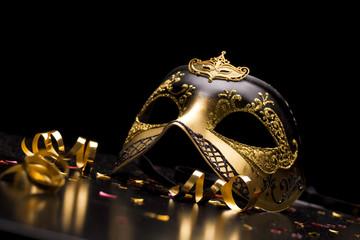 Holiday background; elegant carnival mask