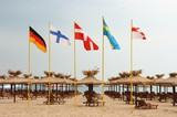 Five flags on the beach