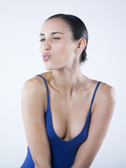 sensual woman sending a kiss with wink