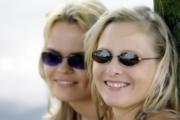 two girls or friends with sunglasses