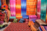 Colorful fabrics for sale in Fes, Morocco poster