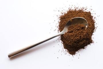 Spoon with coffee on clipping background