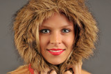 Beautiful woman with furry hood smiling. poster