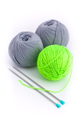 Three balls of wool and two knitting needles