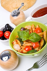 Mediterranean pasta in a green bowl
