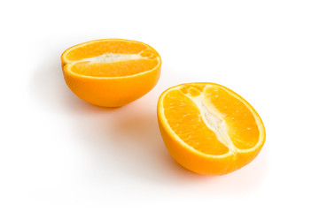 Photo of two halfs of orange isolated on white background