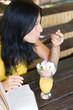 Portrait student girl eating dessert