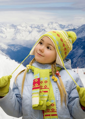 Portrait of a little girl in mountains