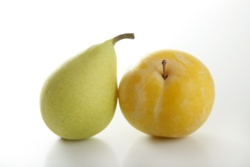 Yellow Mirabelle and Pear on white background