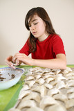 Girl preparing dumplings with mushrooms poster