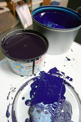 Offset paints (inks) in cans with brushes in publishing house