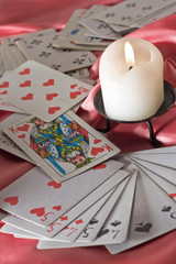 Playing cards and candle