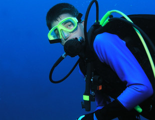 Scuba diver geared up in profile