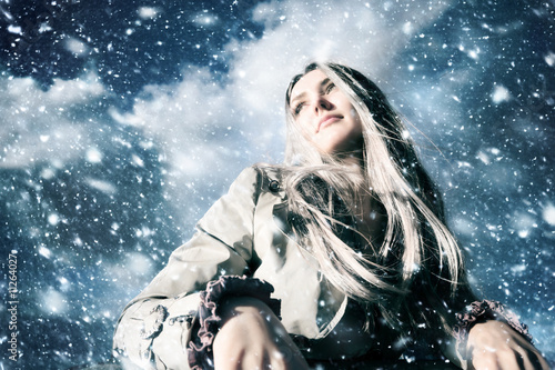 Young blond woman in a blizzard