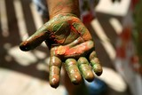 Children artist hands painting multi colors