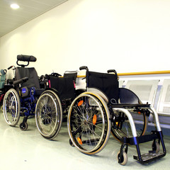 wheel chairs parked in a hospital corridor