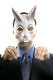 Businessman with funny rabbit mask