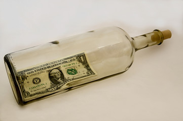 Dollar Bill In An Empty  Bottle