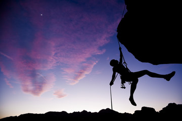 Climber rappelling.